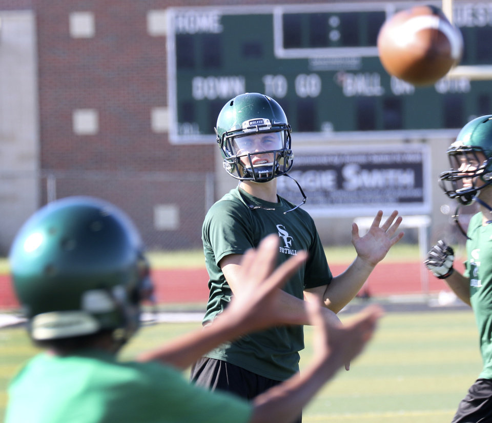 Photo - Edmond Santa Fe's Keaton Torre throws a pass during the teams first practice of the season in Edmond, Friday  August  11, 2014. Photo By Steve Gooch, The Oklahoman