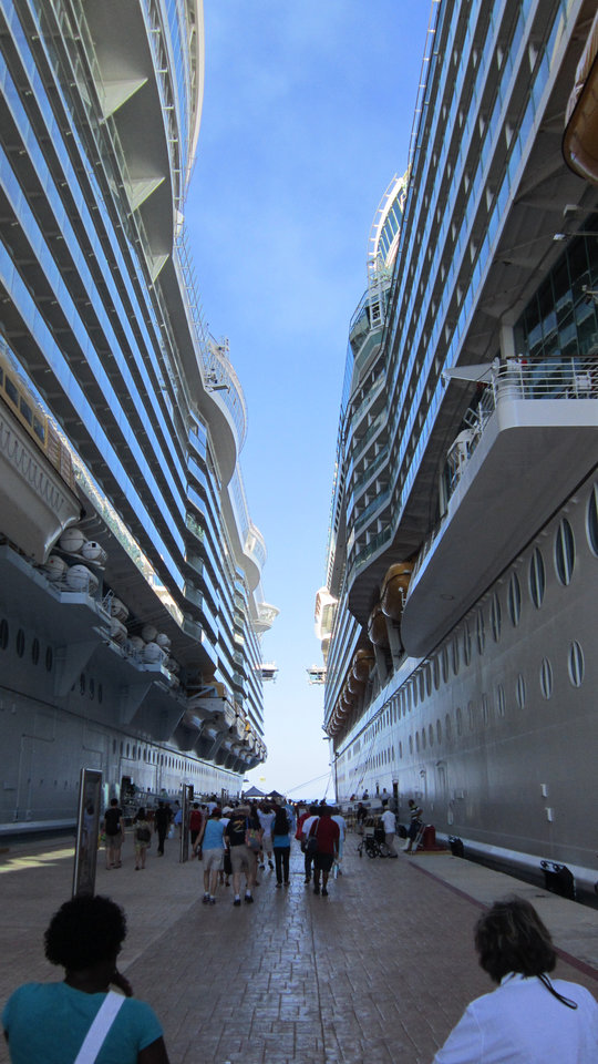 Photo - Royal Caribbean's Navigator of the Seas, right, is docked at Cozumel next to Allure of the Seas.   -  Richard Darnell