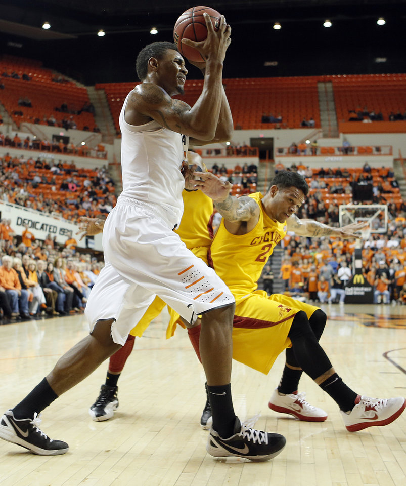 Oklahoma State Cowboys' Le'Bryan Nash (2) fights for the ball with Iowa State Cyclones' Chris Babb (2) during the college basketball game between the Oklahoma State University Cowboys (OSU) and the Iowa State University Cyclones (ISU) at Gallagher-Iba Arena on Wednesday, Jan. 30, 2013, in Stillwater, Okla.  Photo by Chris Landsberger, The Oklahoman