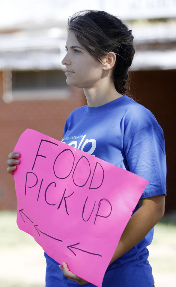 Volunteer Marsela Treska directs traffic during a joint food drive with Feed The Children and Mustard Seed Development Corporation   in Oklahoma City, Tuesday 25, 2012. Photo By Steve Gooch, The Oklahoman
