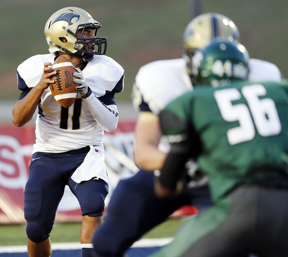 Southmoore's Tre Edwards (11) drops back to pass during a high school football game between Edmond Santa Fe and Southmoore at Wantland Stadium in Edmond, Okla., Thursday, Sept. 20, 2012. Photo by Nate Billings, The Oklahoman
