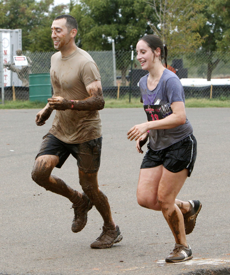 David Leibovich and Anna Christensen run toward the finish line in the Juggernaut mud run at Edmond's J.L. Mitch Park. This was the debut for the Juggernaut in Oklahoma. PHOTO BY PAUL HELLSTERN, THE OKLAHOMAN <strong>PAUL HELLSTERN</strong>