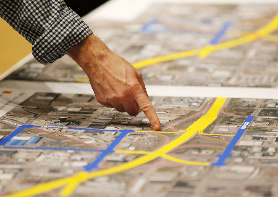 Photo - A man looks at a proposed design for the Oklahoma City Boulevard as it crosses Western, before a public meeting at the Coca-Cola Bricktown Events Center in Oklahoma City, Monday, Dec. 3, 2012. Photo by Nate Billings, The Oklahoman  NATE BILLINGS - NATE BILLINGS