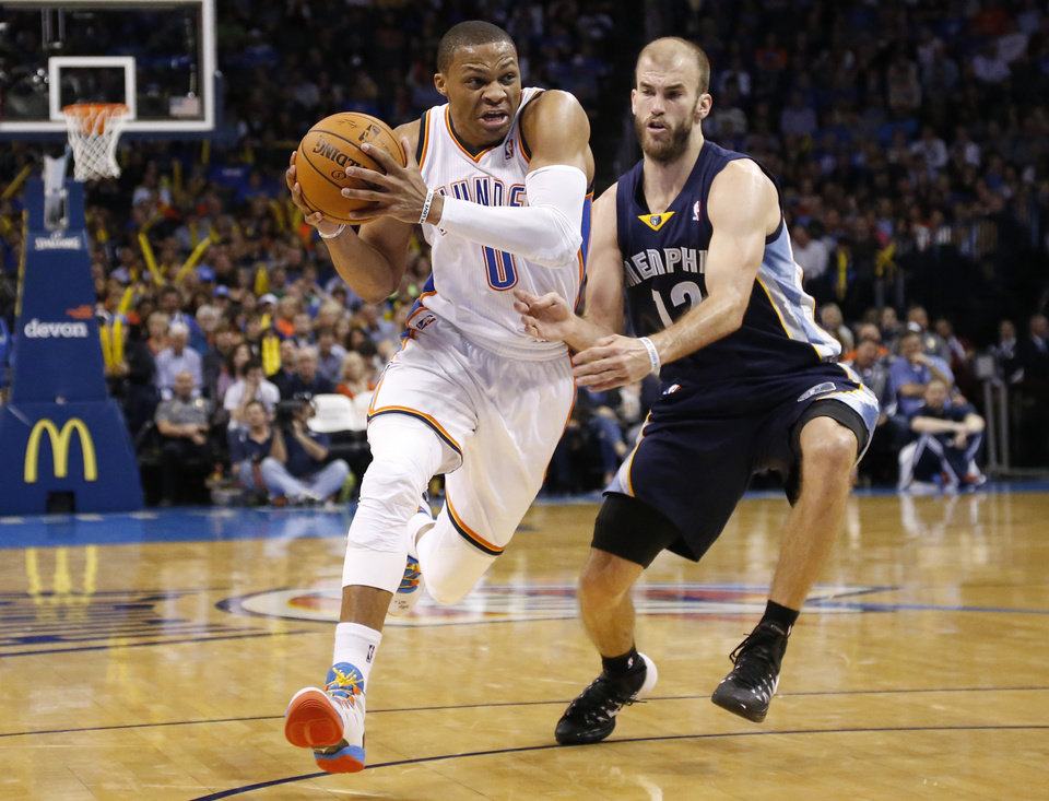 Photo - Oklahoma City Thunder guard Russell Westbrook (0) drives past Memphis Grizzlies guard Nick Calathes (12) during the fourth quarter of an NBA basketball game in Oklahoma City, Friday, Feb. 28, 2014. Oklahoma City won 113-107. (AP Photo/Sue Ogrocki)