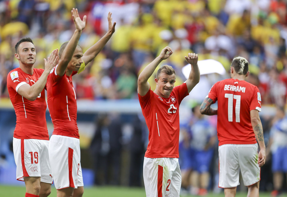 Photo - From left, Switzerland's Josip Drmic, Goekhan Inler, Xherdan Shaqiri and Valon Behrami celebrate after the group E World Cup soccer match between Switzerland and Ecuador at the Estadio Nacional in Brasilia, Brazil, Sunday, June 15, 2014. Switzerland won the match 2-1. (AP Photo/Martin Mejia)