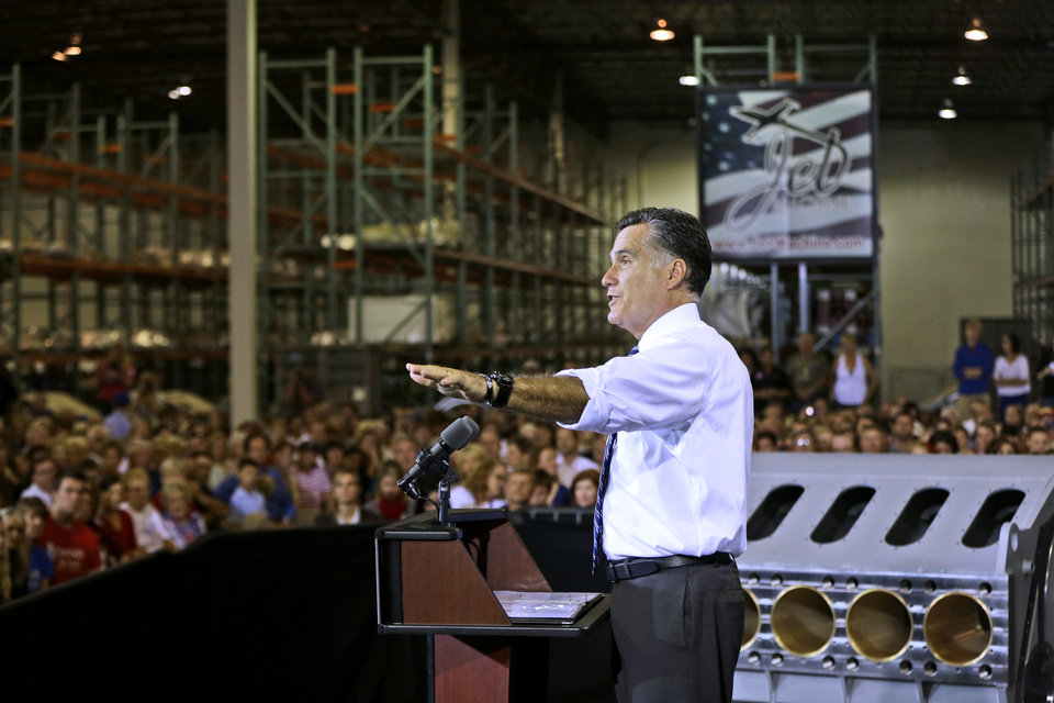 Photo -   Republican presidential candidate, former Massachusetts Gov. Mitt Romney campaigns at Jet Machine, which supplies components for the defense, aerospace, and oil and gas industry, Thursday, Oct. 25, 2012, in Cincinnati, Ohio. (AP Photo/Charles Dharapak)