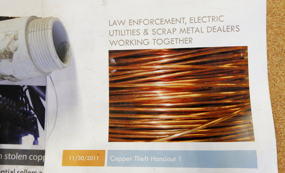 Photo -  A flier about copper theft posted on a bulletin board at Recyclers of Main in Oklahoma City. Fliers like this inform buyers, sellers and scrap yards what items are prohibited from being bought and sold. Photo by Paul B. Southerland, The Oklahoman   PAUL B. SOUTHERLAND -  PAUL B. SOUTHERLAND