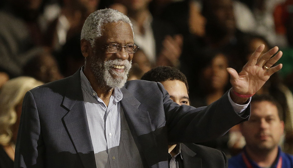 Photo - Former NBA player Bill Russell waves to the crowd during the NBA All Star basketball game, Sunday, Feb. 16, 2014, in New Orleans. (AP Photo/Gerald Herbert)