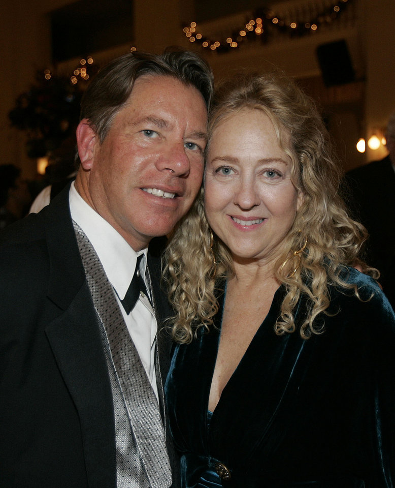 Photo - Rick and Jenny Dunning of Oklahoma City, are shown at the Oklahoma Centennial Statehood Inaugural Ball, Saturday, Nov. 17, 2007, at the Guthrie Scottish Rite Masonic Center, in Guthrie, Okla. By Bill Waugh, The Oklahoman