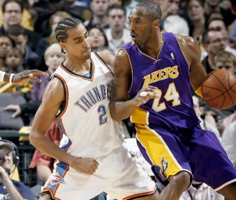 Photo - Oklahoma City's  Thabo Sefolosha guards the Lakers' Kobe Bryant during the NBA basketball game between the Los Angeles Lakers and the Oklahoma City Thunder at the Ford Center,Tuesday, Feb. 24, 2009. PHOTO BY BRYAN TERRY