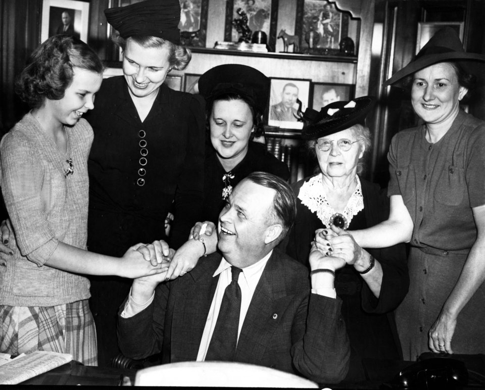"ROBERT S KERR / GOVERNOR / OKLAHOMA:  'CONGRATULATIONS!--It was a joyous occasion as the 'Kerr Girls' gathered around Robert Samuel Kerr early Wednesday to offer congratulations on his election as governor.  Left to right are Grayce Kaye Kerr, 11-year-old daughter; Mrs. Robert S. Kerr; Mrs. Travis Kerr, a sister-in-law; Mrs. Margaret Kerr, mother, and Mrs. Aubrey Kerr, sister-in-law.  The election of Kerr as governor was the best birthday present his mother could receive as she will be 71 years old today."" Staff photo taken 11/3/1942; photo ran in the 11/4/1942 Daily Oklahoman."