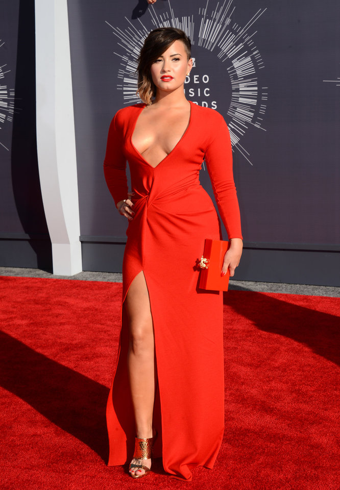 Photo - Demi Lovato arrives at the MTV Video Music Awards at The Forum on Sunday, Aug. 24, 2014, in Inglewood, Calif. (Photo by Jordan Strauss/Invision/AP)