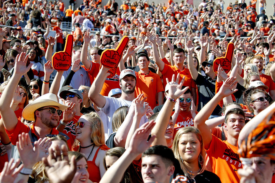 Photo - Fans cheer during the college football game between Oklahoma State University and Baylor at Boone Pickens Stadium in Stillwater, Okla., Saturday, Oct. 19, 2019. Baylor won 45-27. [Sarah Phipps/The Oklahoman]