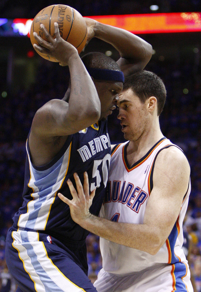 Photo - Memphis Grizzlies forward Zach Randolph, left, works against Oklahoma City Thunder center Nick Collison in the first quarter of Game 7 of a second-round NBA basketball playoff series in Oklahoma City, Sunday, May 15, 2011. (AP Photo/Alonzo Adams)