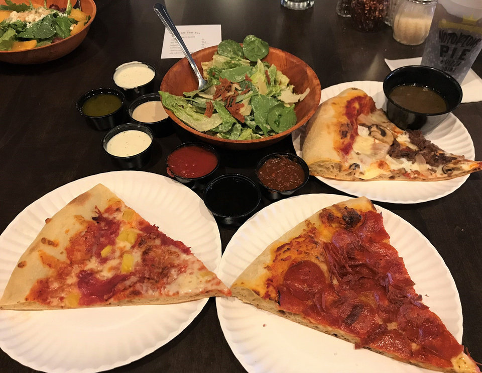 Photo - Notorious P.I.E. in downtown Norman serves pizza, salad, and snacks. [Dave Cathey/The Oklahoman]