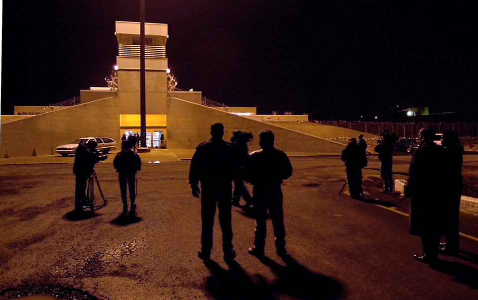 OKlahoma State Penitentiary officials and members of the media wait outside H Unit for the body of Wanda Jean Allen to be removed after her execution Thursday night. Photo by David McDaniel, The Oklahoman