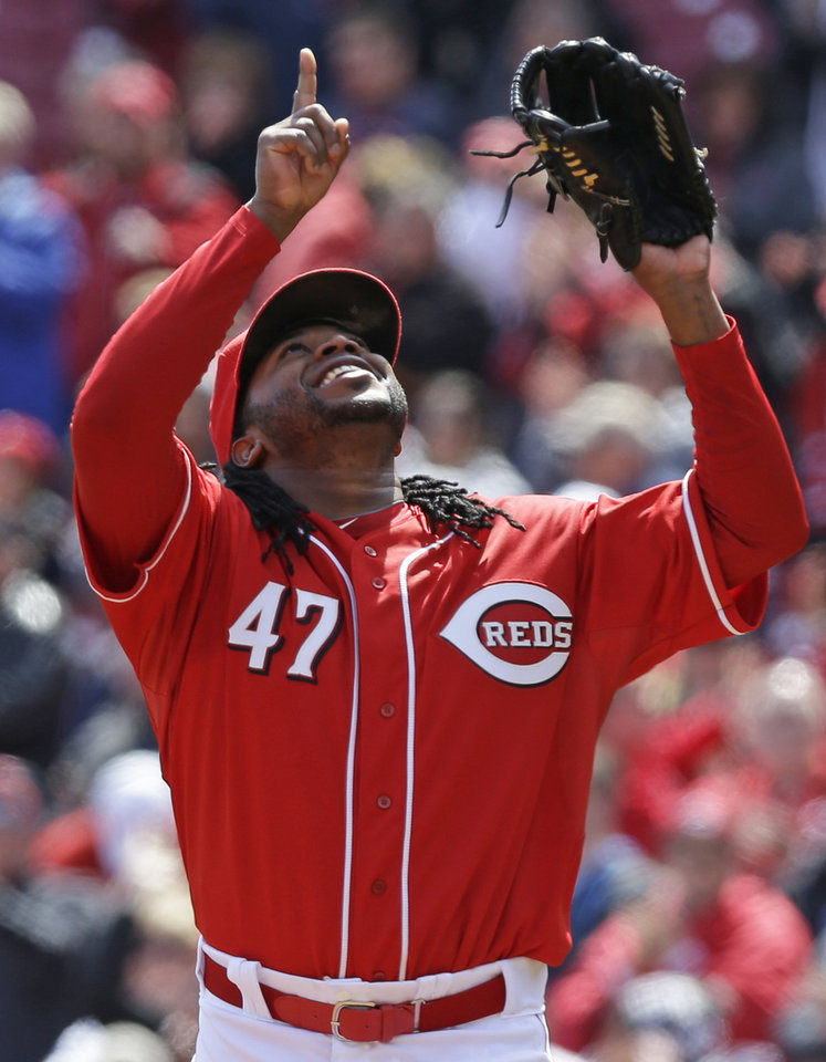 Photo - Cincinnati Reds starting pitcher Johnny Cueto looks up after throwing a complete game, three hit shutout, and striking out 12 batters in a 4-0 win over the Pittsburgh Pirates in a baseball game, Wednesday, April 16, 2014, in Cincinnati. (AP Photo/Al Behrman)