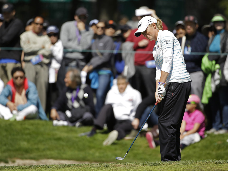 Photo - Stacy Lewis hits out of a bunker onto the sixth green of Lake Merced Golf Club during the final round of the Swinging Skirts LPGA Classic golf tournament on Sunday, April 27, 2014, in Daly City, Calif. (AP Photo/Eric Risberg)