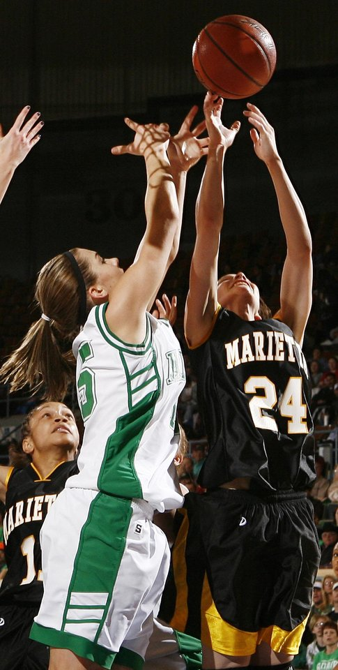 Photo - Adair's Kevi Luper (15) and Marietta's Alyssa Juarez (24) leap for a rebound during the 3A girls semifinal game between Marietta and Adair in the Oklahoma High School Basketball Championships at State Fair Arena in Oklahoma City, Friday, March 13, 2009. Adair won, 55-50. PHOTO BY NATE BILLINGS, THE OKLAHOMAN