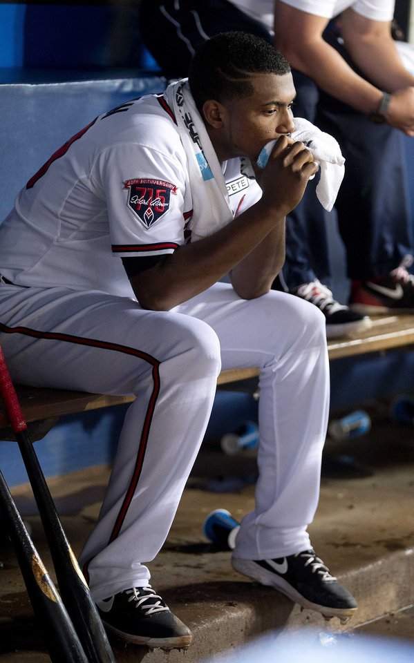 Photo - Atlanta Braves starting pitcher Julio Teheran (49) sits on the bench after being relieved in the eighth inning of a baseball game against the Los Angeles Dodgers  Monday, Aug. 11, 2014 in Atlanta.  (AP Photo/John Bazemore)