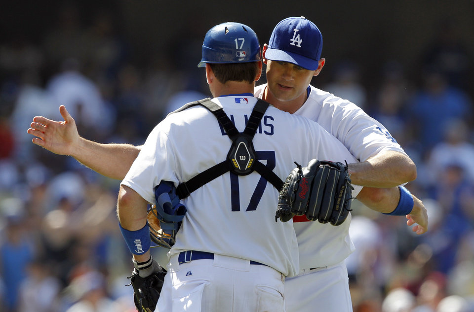 Photo - Los Angeles Dodgers relief pitcher Jamey Wright, right, congratulates catcher A.J. Ellis, left, after defeating the St. Louis Cardinals 6-0 in a baseball game on Sunday, June 29, 2014, in Los Angeles. (AP Photo/Alex Gallardo)