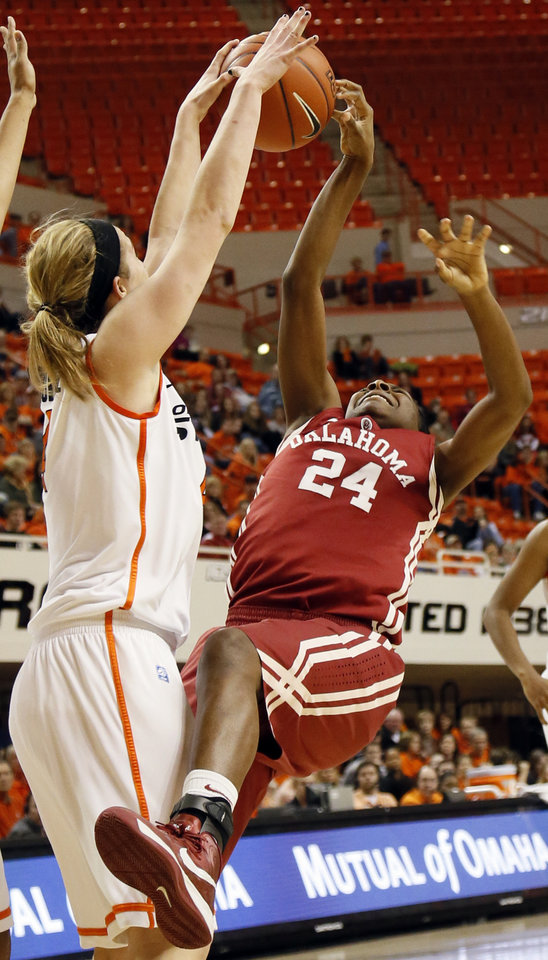 Photo - Oklahoma State's Liz Donohoe (4) blocks the shot of Oklahoma's Sharane Campbell (24) during the Bedlam women's college basketball game between Oklahoma State University and the University of Oklahoma at Gallagher-Iba Arena in Stillwater, Okla., Saturday, Feb. 23, 2013. OSU beat OU, 83-62. Photo by Nate Billings, The Oklahoman