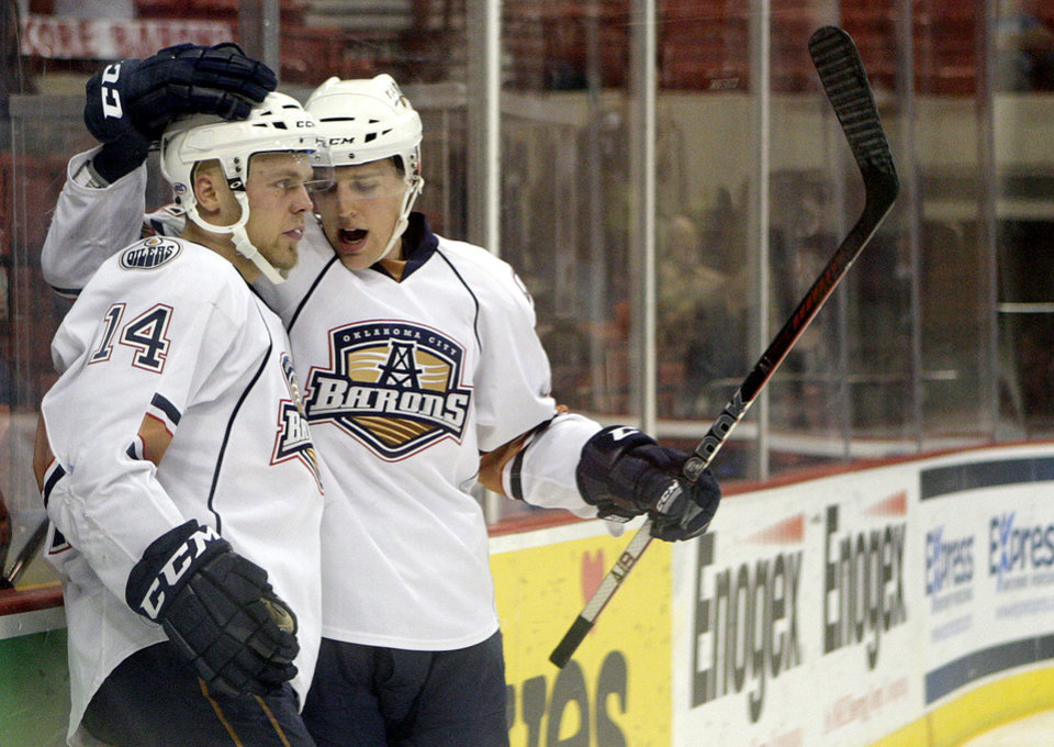 Photo - Oklahoma City's Tanner House (21) and Antti Tyrvainen (14)  celebrate a goal during the AHL hockey game between the Oklahoma City Barons and the Hamilton Bulldogs at the Cox Convention Center in Oklahoma City, Tuesday, April 3, 2012. Photo by Sarah Phipps, The Oklahoman