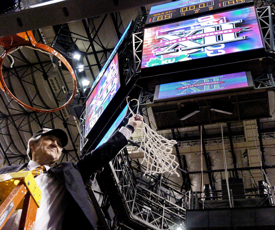 Photo - Oklahoma State University against Texas University during the Big 12 men's college basketball tournament championship game at American Airlines Center in Dallas, Texas, Sunday, March 14, 2004.  OSU head coach Eddie Sutton cuts down the net after winning the Big 12 tournament. Staff photo by Bryan Terry.