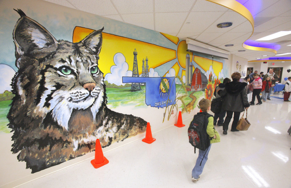 "Students and parents walk past a mural in the cafeteria during a ""Donuts with Dad"" breakfast at Northwood Elementary School in Piedmont Tuesday, Jan 24, 2012. Photo by Paul B. Southerland, The Oklahoman"
