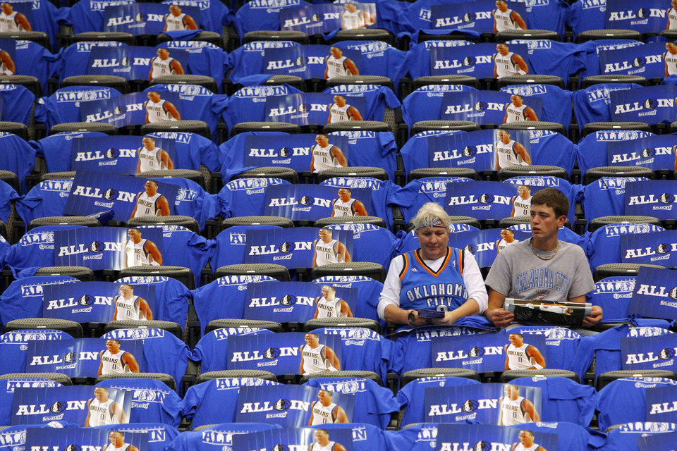 Brenda Hawkins, of Mountain View, Okla., and Clay Davis of Blair, Okla., wait for the start of Game 4 during the first round in the NBA playoffs between the Oklahoma City Thunder and the Dallas Mavericks at American Airlines Center in Dallas, Saturday, May 5, 2012. Photo by Bryan Terry, The Oklahoman