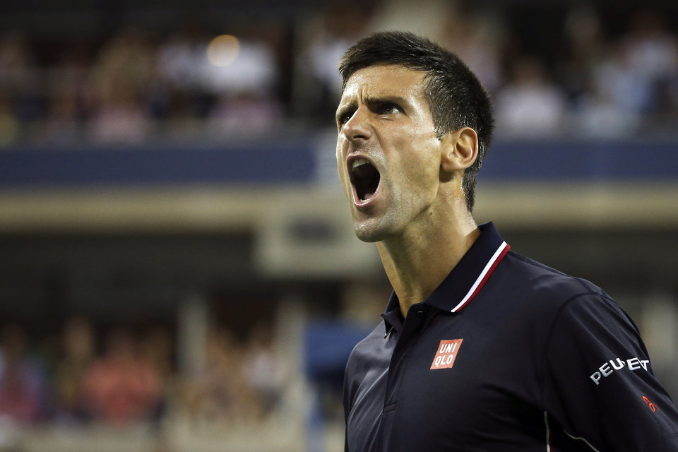 Photo - Novak Djokovic, of Serbia, reacts during a match against Andy Murray, of Britain, during the quarterfinals of the U.S. Open tennis tournament, Wednesday, Sept. 3, 2014, in New York. (AP Photo/John Minchillo)
