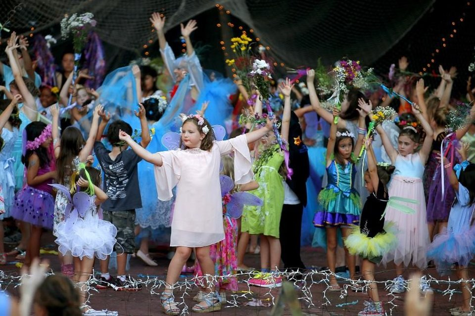 Photo - Children dance on stage during the 2019 Fairy Ball, presented by Theatre Upon a StarDanceSwan at the Crown Jewel Amphitheater at First Christian Church in Oklahoma City, Saturday, June 29, 2019. [Bryan Terry/The Oklahoman Archives]