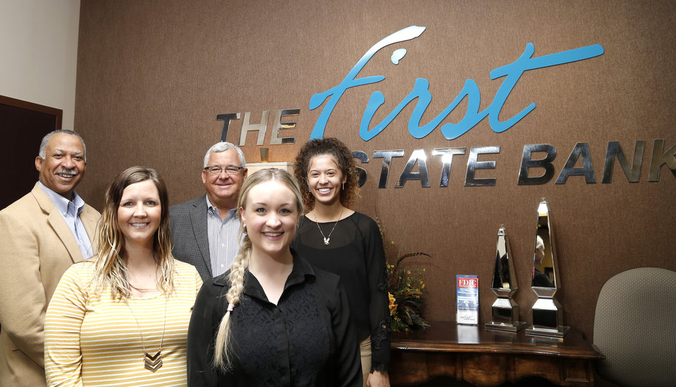 Photo -  From left, Christopher Turner, Britni Tull, David Durrett, Kayla Botkin and McKenna Henry pose Nov. 8 for a photo at The First State Bank in Oklahoma City. [PHOTO BY SARAH PHIPPS, THE OKLAHOMAN]