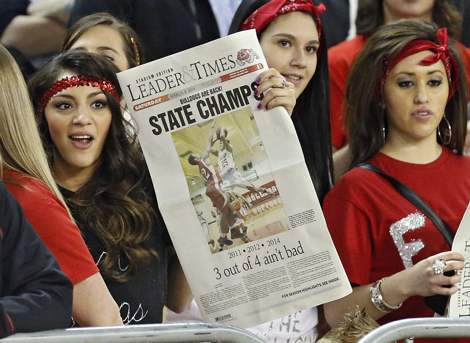 Photo - A Forgan fan holds up a state champion poster as the Bulldogs defeat Lookeba-Sickles during the Class B boys high school basketball state championship game between Forgan and Lookeba-Sickles at the State Fair Arena in Oklahoma City, Okla., on Saturday, March 8, 2014.  Photo by Chris Landsberger, The Oklahoman