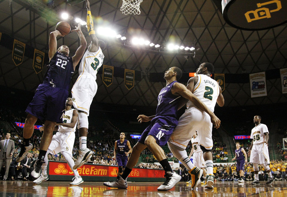 Northwestern center Alex Olah (22) shoots against Baylor's Cory Jefferson (34) as Northwestern's Reggie Hearn and Baylor's Rico Gathers (2) watch in the first half of an NCAA college basketball game, Tuesday, Dec. 4, 2012, in Waco, Texas. (AP Photo/Tony Gutierrez)