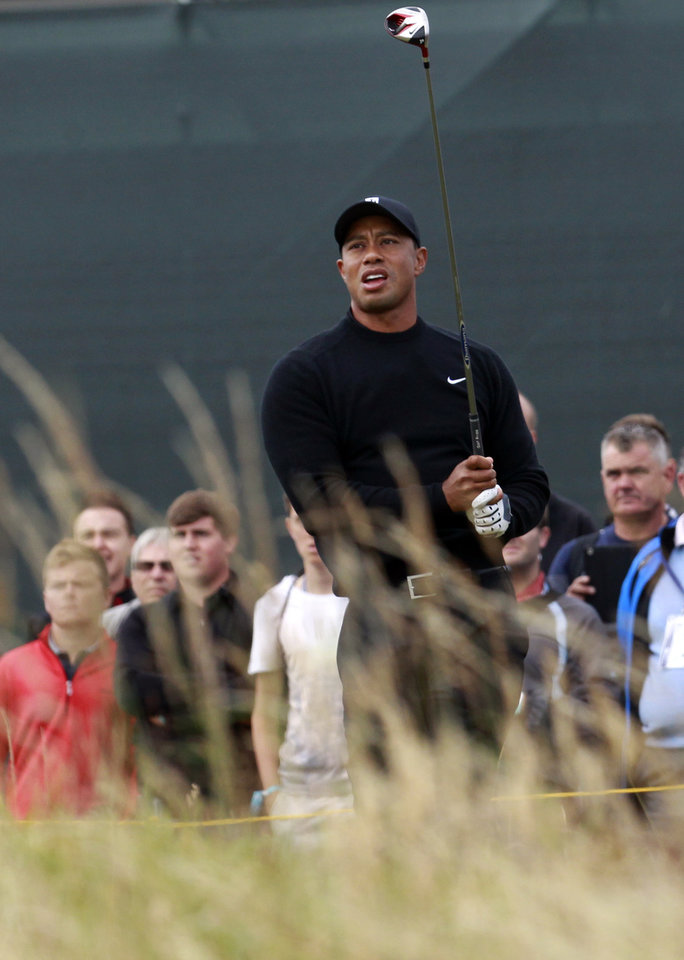 Photo - Tiger Woods of the US watches his shot off the 5th tee during a practice round ahead of the British Open Golf championship at the Royal Liverpool golf club, Hoylake, England, Tuesday July 15, 2014. The British Open starts on Thursday July 17. (AP Photo/Peter Morrison)