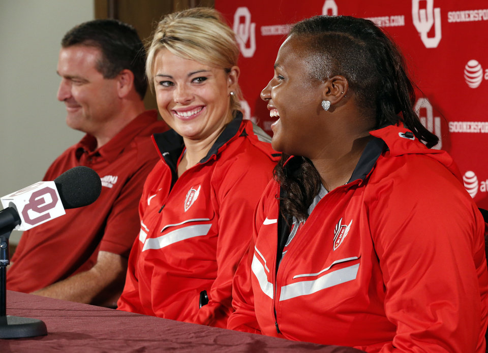 Photo - Shot put thrower Tia Brooks (right) laughs during a press conference on Thursday, July 5, 2012 in Norman, Okla. She and javelin thrower Brittany Borman (center) are among six athletes from the University of Oklahoma who have qualified for the 2012 London Olympics in track and field, wrestling and men's gymnastics.  At left is their coach Brian Blutreich.  Photo by Steve Sisney, The Oklahoman