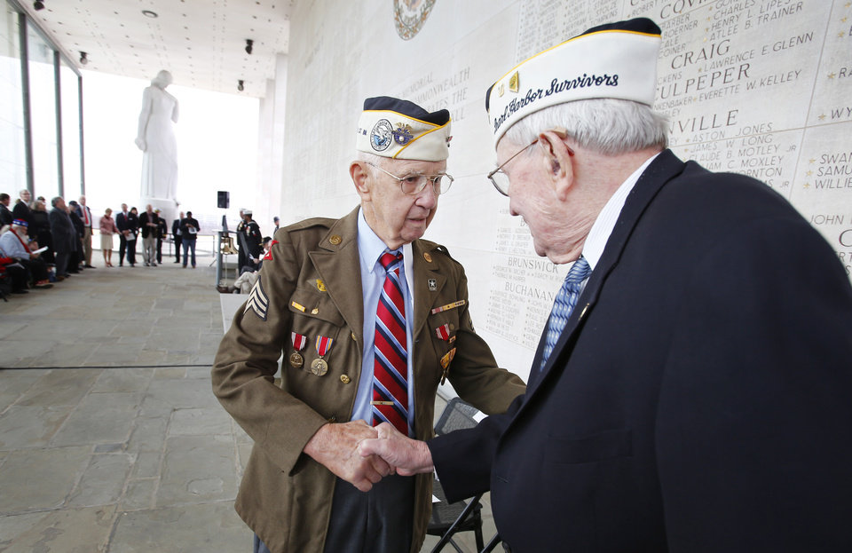 Photo - Pearl Harbor survivors Max Green, left,  and Bill Thornton greet each other prior to the Pearl Harbor Day Remembrance Ceremony at the Va. War Memorial, in Richmond, Va. on Friday, Dec. 7, 2012.  The ceremony remembers those Virginians who died during the Japanese attack on Pearl Harbor, Hawaii on December 7, 1941. (AP Photo/Richmond Times-Dispatch, Dean Hoffmeyer)