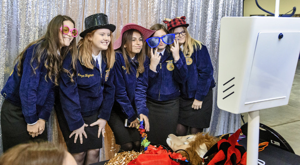 Photo - Students from Wyandotte get dressed up to take photos together during the annual Oklahoma FFA Convention at the Cox Convention Center in Oklahoma City, Okla. on Tuesday, May 1, 2018.  . Photo by Chris Landsberger, The Oklahoman