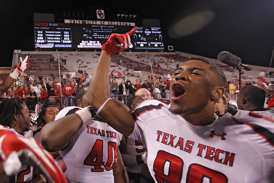 Photo - Texas Tech's Marcus Kennard (88) celebrates the 41-38 win over Oklahoma during the college football game between the University of Oklahoma Sooners (OU) and Texas Tech University Red Raiders (TTU) at the Gaylord Family-Oklahoma Memorial Stadium on Sunday, Oct. 23, 2011. in Norman, Okla. Photo by Chris Landsberger, The Oklahoman