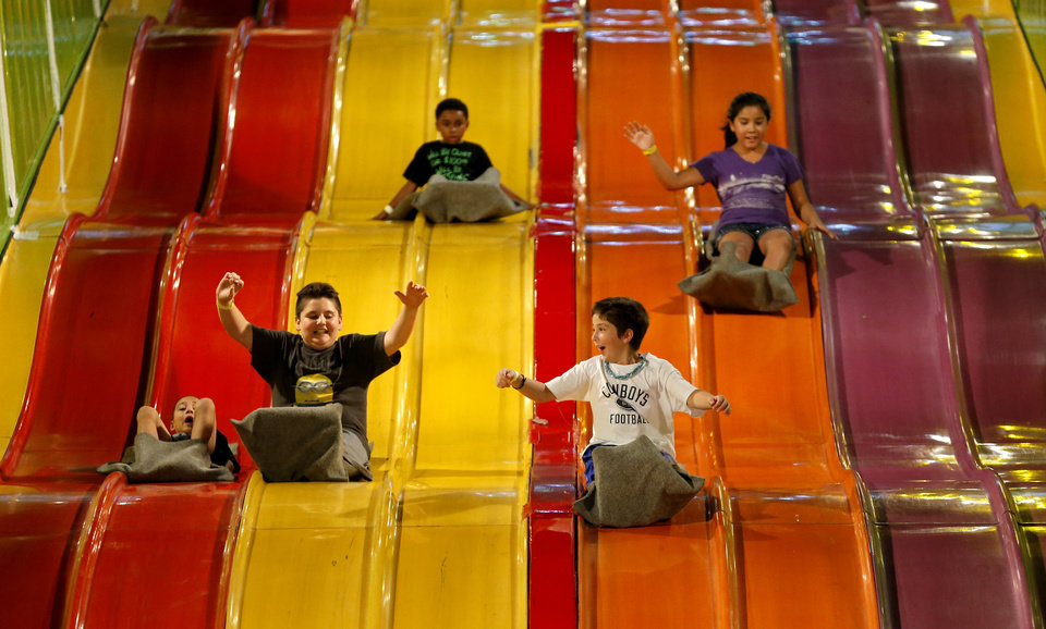 Children ride down a slide at the Oklahoma State Fair in Oklahoma City, Wednesday, Sept. 18, 2013. Photo by Bryan Terry, The Oklahoman