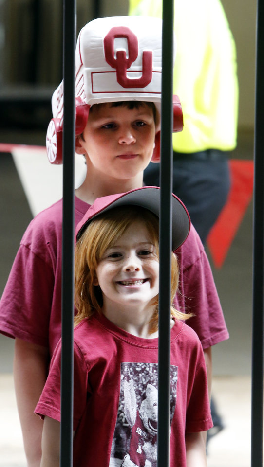 Photo - Fans Michael Allen, 6, bottom, and Christopher Feltz, 12, line up for the University of Oklahoma Sooner (OU) football team fan appreciation day at Gaylord Family-Oklahoma Memorial Stadium in Norman, Okla., on Saturday, Aug. 3, 2013. Photo by Steve Sisney, The Oklahoman