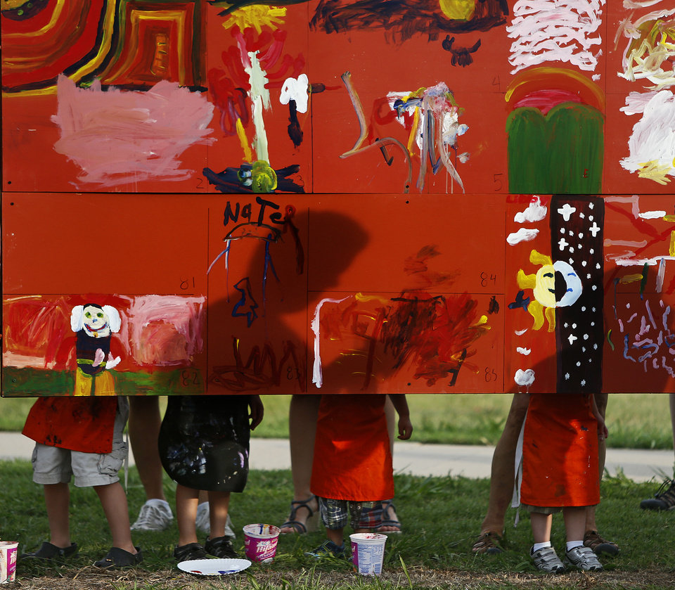 Children paint the children's art wall Saturday during the Midsummer Nights' Fair in Norman.  Photos by Bryan Terry, The Oklahoman