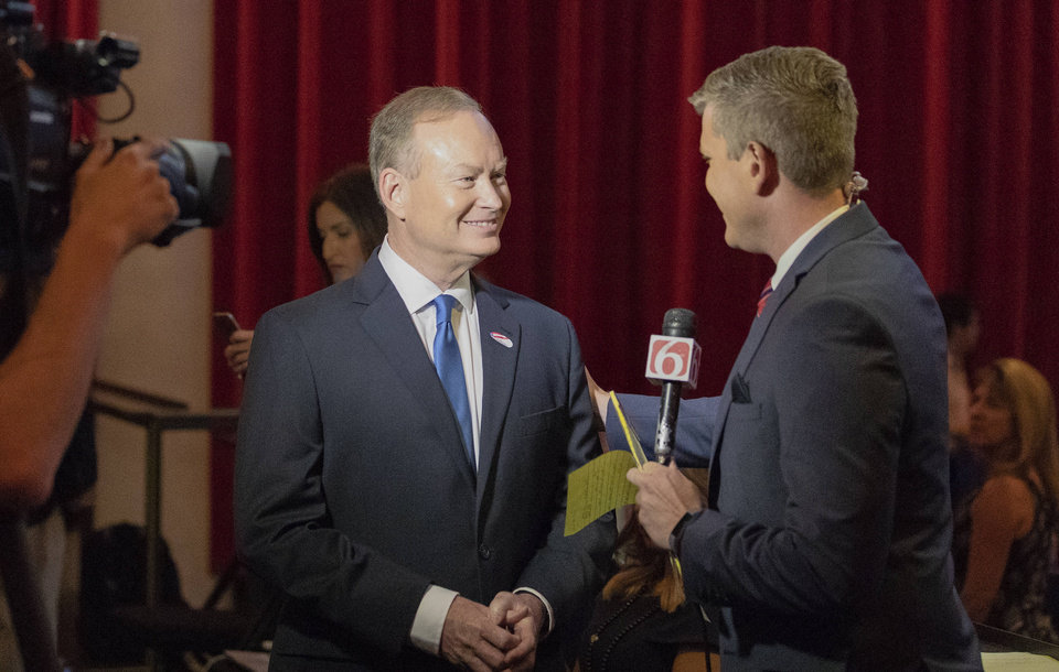 Photo - Mick Cornett speaks with a KOTV 6 reporter at his watch part inside the Tower Theater in Oklahoma City, Okla. on Tuesday, June 26, 2018. (Photo by Alonzo Adams for The Oklahoman)