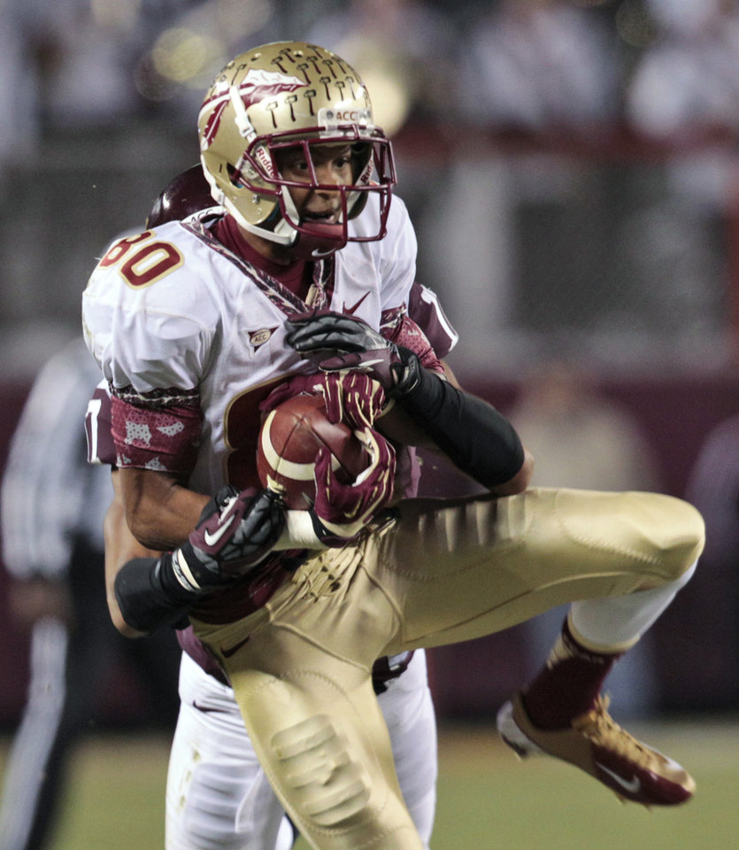 Photo -   Florida State wide receiver Rashad Greene hauls in a pass during the first half of an NCAA college football game against Virginia Tech in Blacksburg, Va., Thursday, Nov. 8, 2012. (AP Photo/Steve Helber)