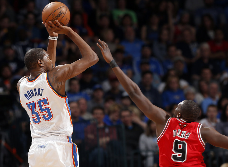 Photo - Oklahoma City's Kevin Durant (35) shoots over Chicago's Luol Deng (9) during the NBA game between the Oklahoma City Thunder and the Chicago Bulls at Chesapeake Energy Arena in Oklahoma City, Sunday, Feb. 24, 2013. Photo by Sarah Phipps, The Oklahoman