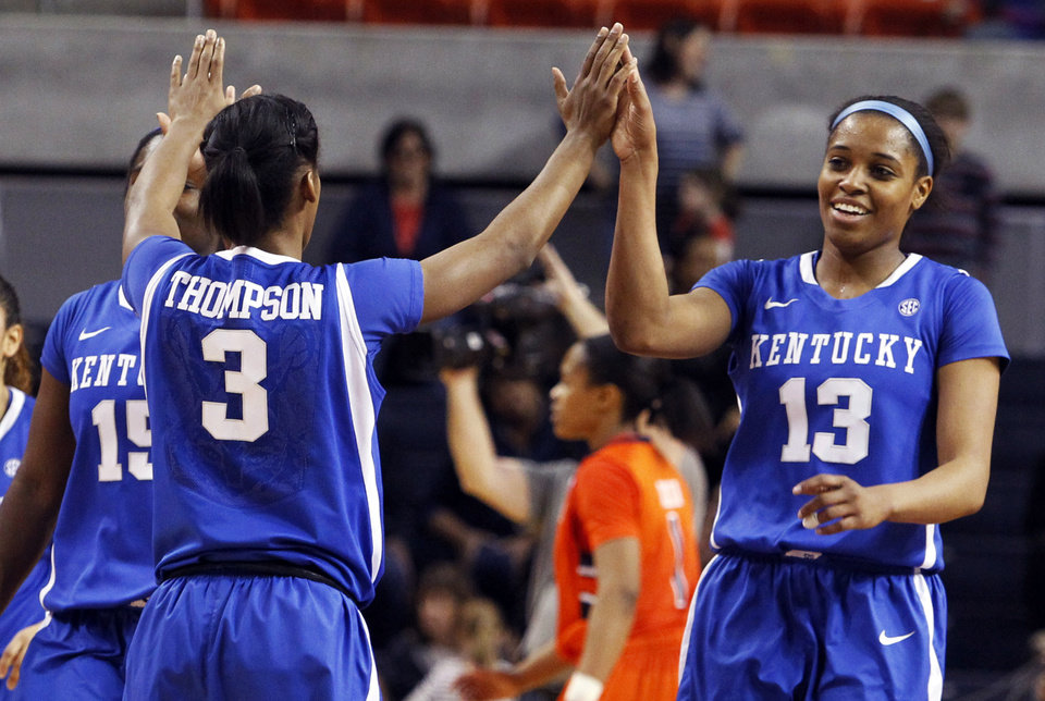 Photo - Kentucky's Janee Thompson (3) gives high-fives to teammates, Linnae Harper (15) and Bria Goss (13) after they held on to defeat Auburn 73-71 in an NCAA women's college basketball game on Sunday, Jan. 19, 2014, in Auburn, Ala. (AP Photo/Butch Dill)