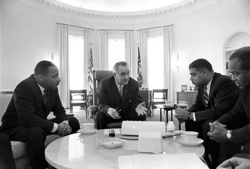 "Photo - In this image from the LBJ Presidential Library, from left Martin Luther King Jr., President Lyndon B. Johnson, Whitney Young, James Farmer attend a meeting on Civil Rights in the Oval Office of the White House on Jan. 18, 1964, in Washington. Rep. John Lewis, D-Ga., tells the story of Young's boldness in dealing with civil rights issues in ""The Powerbroker: Whitney Young's Fight For Civil Rights"" a documentary airing during Black History Month on PBS' Independent Lens and shown in some community theaters. (AP Photo/LBJ Presidential Library, Yoichi Okamoto)"