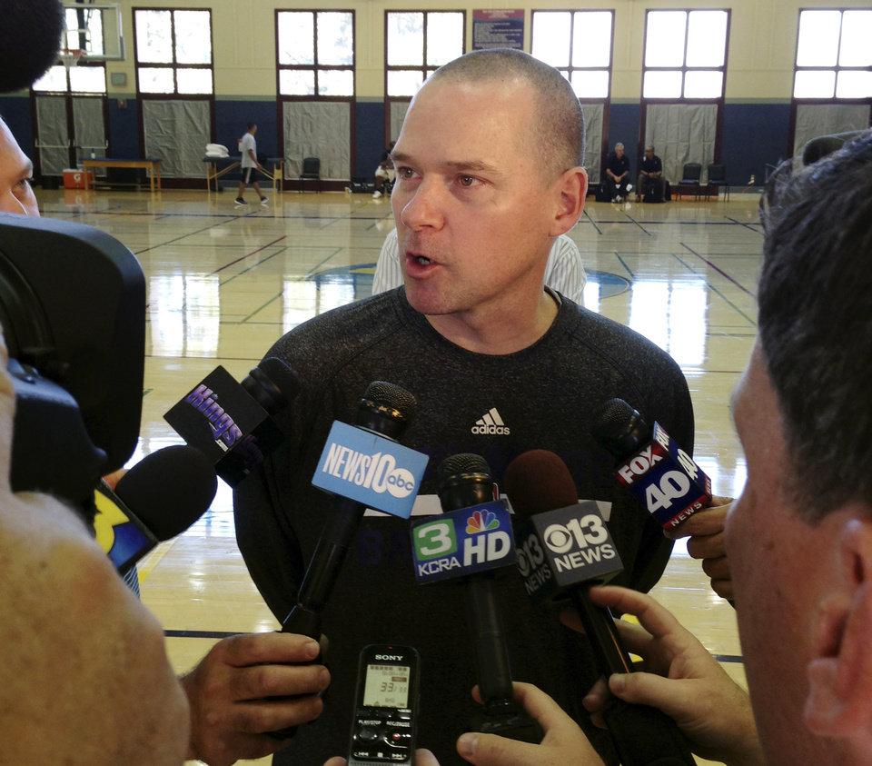 Photo - Sacramento Kings coach Mike Malone speaks with the media after the first practice of NBA basketball training camp on Tuesday, Oct. 1, 2013, in Santa Barbara, Calif. The Kings are hoping their successful summer leads to more victories this season with a new coaching staff, front office and ownership group. (AP Photo/Greg Beacham)