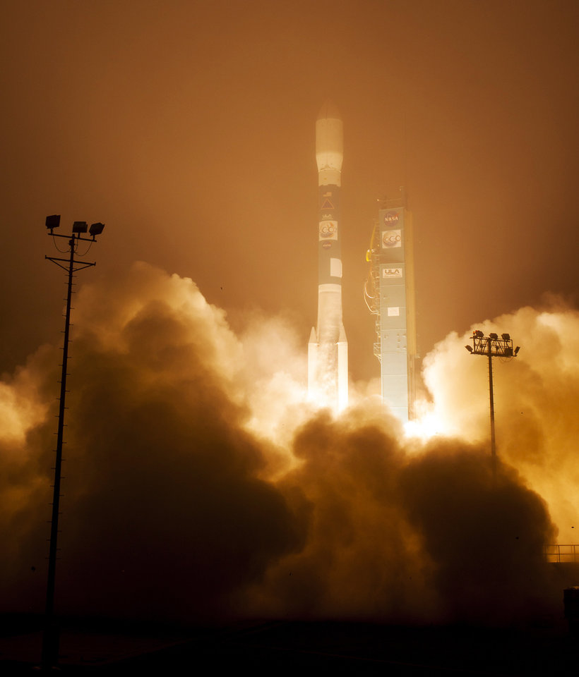 Photo - In this image released by NASA, a Delta 2 rocket with the Orbiting Carbon Observatory-2 satellite launches at Vandenberg Air Force Base, Calif., Wednesday morning, July 2, 2014.  The goal of the $468 million mission, designed to last at least two years, is to study the processes behind how the environment absorbs carbon dioxide.  (AP Photo/NASA, Bill Ingalls) MANDATORY CREDIT
